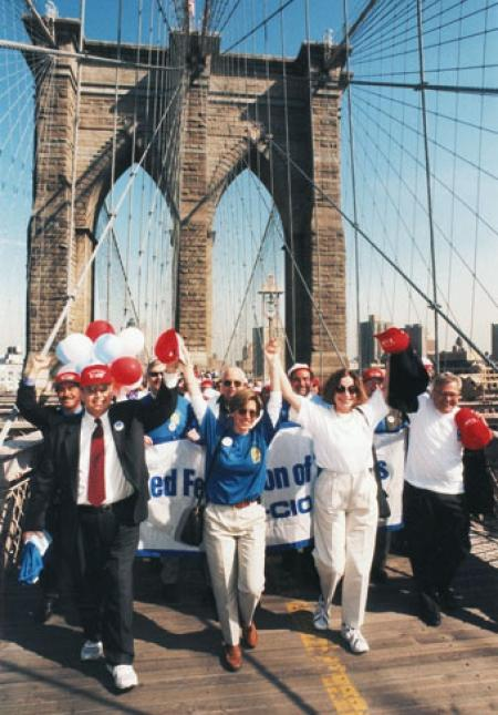 Randi Weingarten leads marchers across Brooklyn Bridge