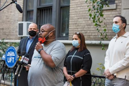 Allister Johnson (at microphone), the chapter leader at P811 in Manhattan, speaks about the first day back for District 75 students during a Sept. 21 press conference. Looking on are (from left) UFT President Michael Mulgrew and teachers Miguelina O'Connor and Steven Chirieleison.