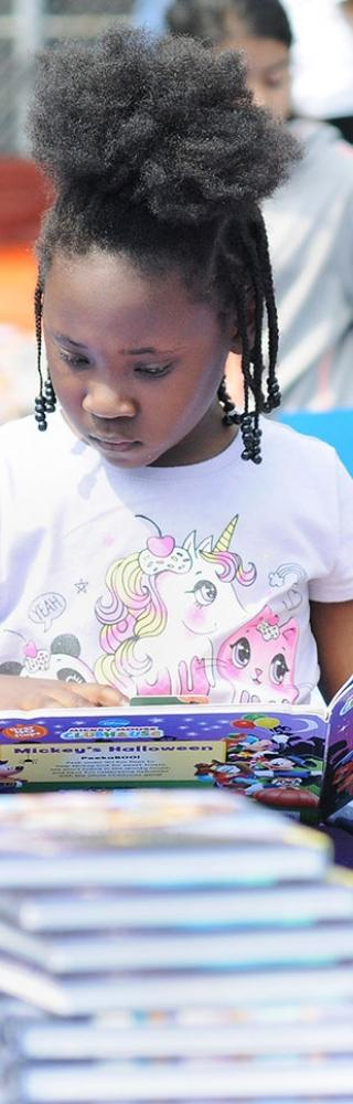 A 1st-grader reads a book.