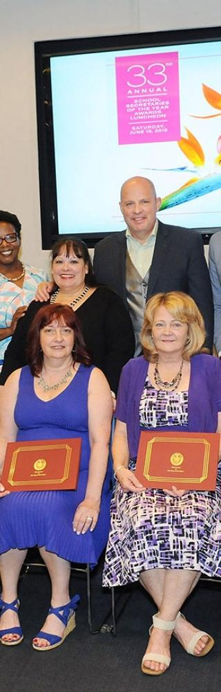 School Secretaries of the Year are joined by UFT officers and staff.