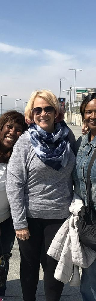 Four school nurses at the PSRP conference relax along the Detroit River.