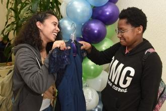 Katelyn Maldonado (left), a teacher at IS 217 in the Bronx, is impressed by her