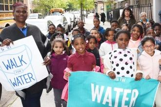 Students at PS 81in Brooklyn marched through the neighborhood with signs demanding clean drinking water.