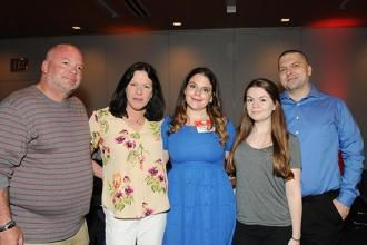 Courtney Holder (center), the recipient of the RN Advocate Award for Justice, celebrates with her family.