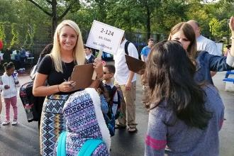 2nd graders in class 2-124 are greeted with smiles as they check in with Ms. Ega