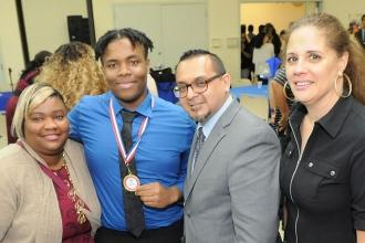 Bronx Academy of Health Careers school counselor Paulo Seminario (second from ri