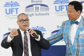 UFT Bronx High Schools District Representative Eliu Lara (left) introduces the k