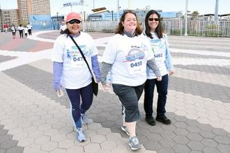 Three women wearing UFT Union Proud shirts walking on boardwalk