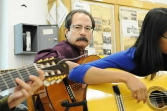 "Newtown HS music teacher Fred Vasquez performs ""El Cumbanchero."""