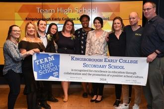 Members from Kingsborough Early College Secondary School in Brooklyn are all smi