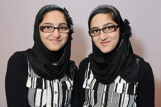 New Utrecht HS twins Rabia (left) and Rimsha Ansar not only look alike, but they