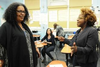 UFT Vice President Janella Hinds (right) talks to paraprofessional Sara Quinones