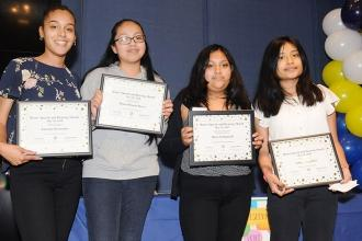 Speech provider Amanda Bermudez (left) and her students from IS 145 in Queens we