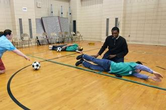 Students take a break from the braille activities to play goal ball, a Paralympi