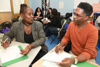 Parents Christian Pinkney of PS 221 and Marcus Allen of MS 266 compare notes at