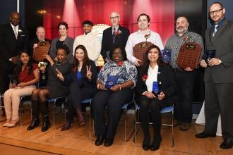 Posing with the Outstanding Educator honorees from Brooklyn are (standing, from
