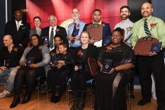 Outstanding Educator Award winners from Manhattan are joined by (standing, from
