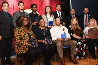 The Outstanding Educator honorees from Queens are flanked by UFT Queens High Sch