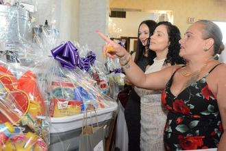 The gift basket raffle raises money and draws more than a little interest from (