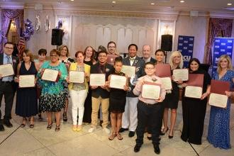 All of the honorees proudly display their certificates.