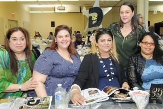 PS 195 PTA President Veronica Ortiz (seated second right), one of the day's hono