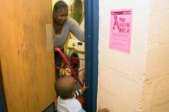 Rita McClinton uses the washer and dryer at PS 15. She shares her three-bedroom