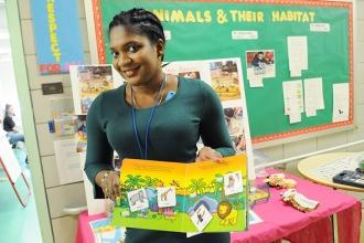 Yanique Douglas shows off her students' habitat project.