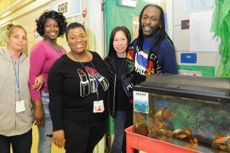 All smiles during the event are (from left) paraprofessional Lakisha Thompson, t