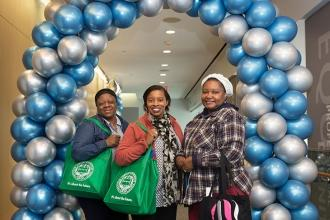 Teacher Debra Edmund (center) of PS 193 in Brooklyn took two guests to the event