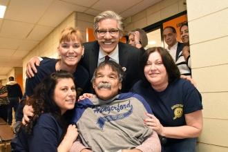 Newsman Geraldo Rivera (standing, center) and former Willowbrook State School re