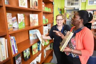 Two women looking at shelf of books