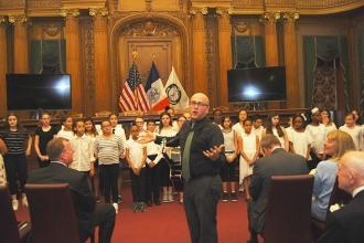 The PS 222, Brooklyn, chorus with music teacher Jason Luft.