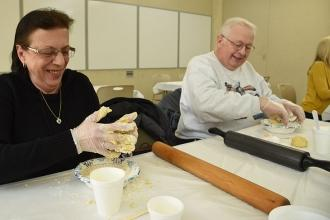 Retirees Denise and Alexander Famularo combine flour and egg for their handmade