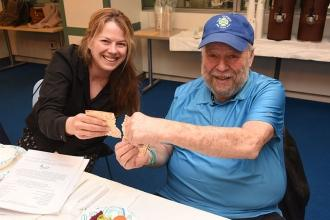 Sarah Evens of MS 172 in Queens breaks matzo with her dad, Marc Evens.