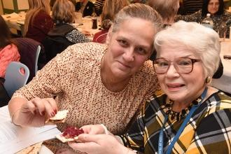 Sharing a horseradish sandwich are Teri Buch (left) of PS 226 in Manhattan and J