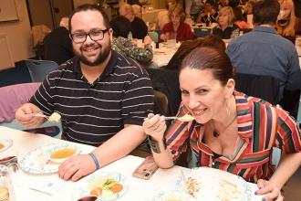 Smiling with their matzo ball soup are Manhattan educators Farrah Alexander of P