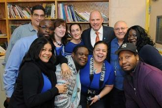 UFT President Michael Mulgrew (back, center) with faculty and staff at the Bronx