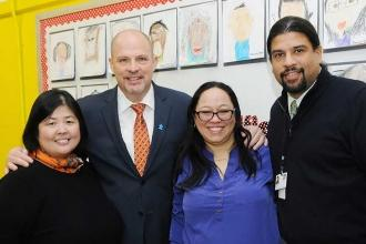 Getting together at PS 51 are (from left) Principal Dr. Min Hong, Mulgrew, Chapt