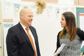 Mulgrew stops by the classroom of Lorge School teacher Amanda Byrnes during his