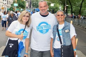 Group of three people wearing Union Proud shirts
