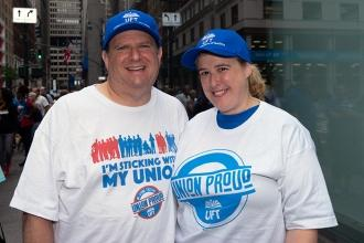 Man and woman wearing union shirts