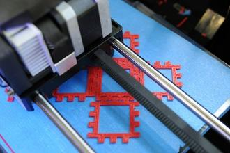 The 3D computer prints out the geometric forms that 8th-grade math students will