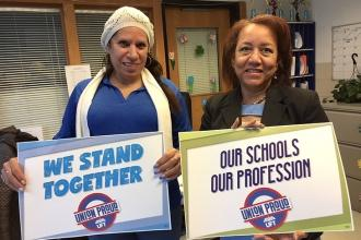 8-	Shirley Ortiz, left, and Ana Seales-Lifang wear blue at P168X. Both are schoo