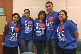 Paraprofessionals show love for public schools at PS 152 in Woodside, Queens.