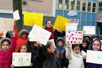 Students rallied to show love for their school at PS 128 in Washington Heights.