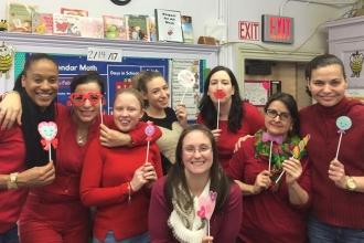 Teachers at P.S. 39 District 15 celebrate Respect for All Week in red to show th