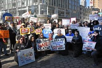 Some of the 300 UFT members who attended the New York City march gathered for a