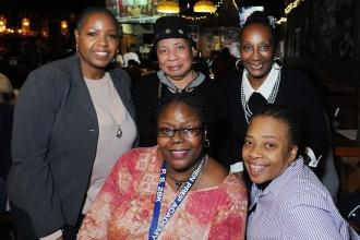 UFT District 16 Representative Camille Eaddy (standing, right) with members from