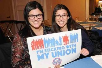Lauren Minichello (left) and Jacquelyn Violetta, teachers at PS 6, show how they