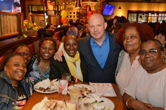 Mulgrew and UFT District 16 Representative Camille Eaddy (fourth from left) stop